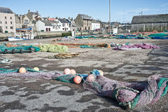 Fishing nets. With attached bouys,  laid out to dry at Burghead, a small fishing port on the North East coast of Scotland Stock Photography