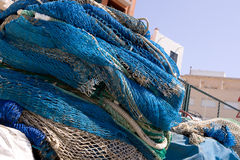 Fishing nets. Piled up in fishing port Royalty Free Stock Photography
