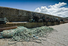 Fishing nets. & Arbroath Harbour, Cornwall stock photos