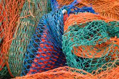 Fishing nets. Close up of multi coloured industrial fishing nets royalty free stock photo