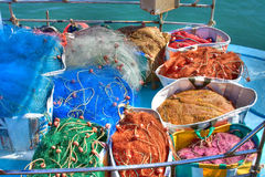 Fishing nets. Colourful fishing nets in baskets on the deck of a fishing boat Royalty Free Stock Image