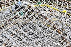 Fishing nets. Closeup of fishing nets on dock stock images