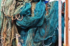 Fishing Nets. Bunched up on the deck of a boat royalty free stock photography