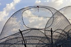 Fishing nets in Abu Dhabi, UAE. Fishing industrial tool at the pier against blue sky Stock Photography