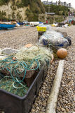 Fishing nets and associated paraphernalia. Trawler fishing nets and equipment set out on the stony beach at Beer, Devon, England, United Kingdom Stock Image