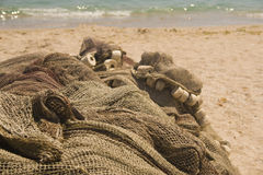 Fishing nets on beach Royalty Free Stock Image
