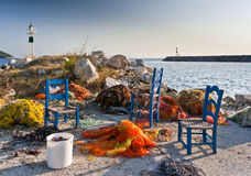 Fishing nets and blue chairs Stock Photography
