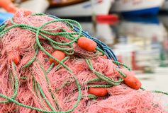 Fishing nets with blue, green, orange colors. Stock Photo