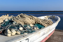 Fishing nets by boat before going out to sea Stock Photo