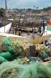 Fishing nets and boats on Cape Coast foreshore Stock Photography