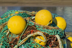 Fishing nets and buoys on a fishing boat royalty free stock photos