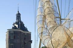 Fishing nets, the city gate Drommedaris, Enkhuizen Stock Photos