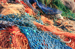 Fishing nets. Close up of a pile of colourful fishing nets. Very shallow depth of field Royalty Free Stock Images