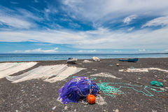 Fishing nets drying on the black beach Royalty Free Stock Image