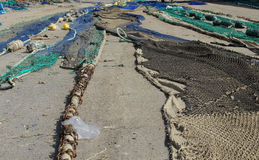 Fishing nets drying on the ground Stock Images