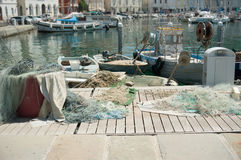Fishing nets drying in the harbor Royalty Free Stock Photo