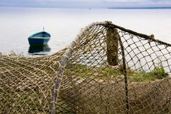 Fishing nets drying on shore Stock Photo