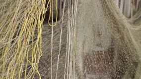 Fishing nets drying in the wind stock video