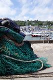 Fishing nets at an english harbour. Boats in an english harbour Royalty Free Stock Photos