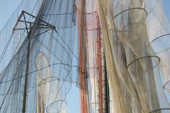 Fishing nets and fish-traps. Detail of the colourful fishing nets and fish-traps hanging drying in sun and wind Royalty Free Stock Photos