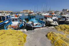 Fishing nets and fishing boats near Venetian fortress in the por Stock Photos
