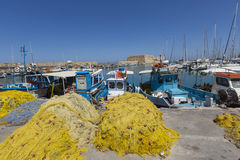 Fishing nets and fishing boats near Venetian fortress in the por Stock Photo