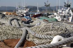 Fishing nets for fishing in the sea. Next to a boat on the water Stock Photography
