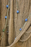 Fishing Nets with Floats. Fishing net with blue and green floats Royalty Free Stock Images