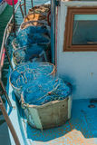 Fishing nets and floats in baskets after fishing. Stock Photos