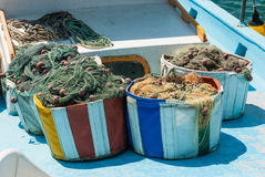 Fishing nets and floats in baskets after fishing. Stock Image