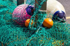Fishing nets and floats at West bay stock photo