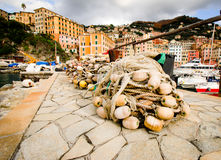 Fishing nets in front of famous town and harbor camogli in genoa italy stock photos