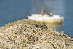 Fishing nets in front of a fishing boat Royalty Free Stock Image