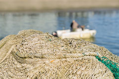 Fishing nets in front of a fishing boat Stock Photos