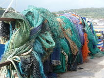 Fishing nets hanging out to dry. At a coastal town in South West England UK Stock Photo