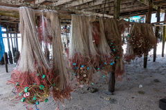 Fishing nets hanging under house in fishing village, Chomphon, T Royalty Free Stock Photography