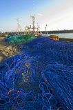 Fishing nets on harbour quay. Trawl fishing nets on the quayside of a harbour Royalty Free Stock Photography