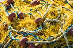Fishing nets. Heap of fishing nets  with rope and floatings royalty free stock images