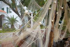 Fishing nets hung on the fence for drying on the background of the house. Starigrad-Paklenica. Croatia stock photos