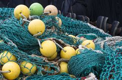 Disordered fishing nets. Image shows background of colorful fishing nets and floats royalty free stock photo