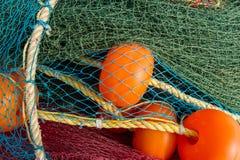 Fishing nets with large floats. Fishing tackle, fishing, accessories, supplies, marine life, fishing, mining, fishing, industrial fishing, drying nets, preparing Royalty Free Stock Photo