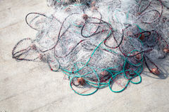 Fishing nets lay on concrete pier Stock Photos