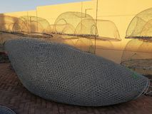 The fishing gear. Fishing nets lit by the setting sun royalty free stock photos