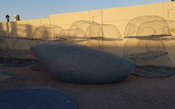The fishing gear. Fishing nets lit by the setting sun royalty free stock photography