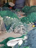 Fishing nets, lobster pots and floats, all get prepred for the day work at sea. A Fisherman`s work doesn`t end at sea; in harbour he must repair and prepare all stock photography