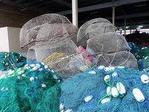 Fishing nets, lobster pots and floats, all get prepred for the day work at sea. A Fisherman`s work doesn`t end at sea; in harbour he must repair and prepare all royalty free stock image