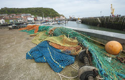 Fishing nets lying on quayside Stock Image
