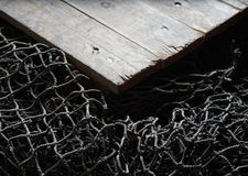 Fishing nets over wooden background with copy space. Royalty Free Stock Images