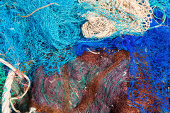 Fishing nets pattern mess stacked at port Royalty Free Stock Images
