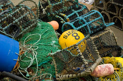 Fishing nets and pots. Fishing nets and lobster pots on quayside, number eight 8 prominent Stock Photo